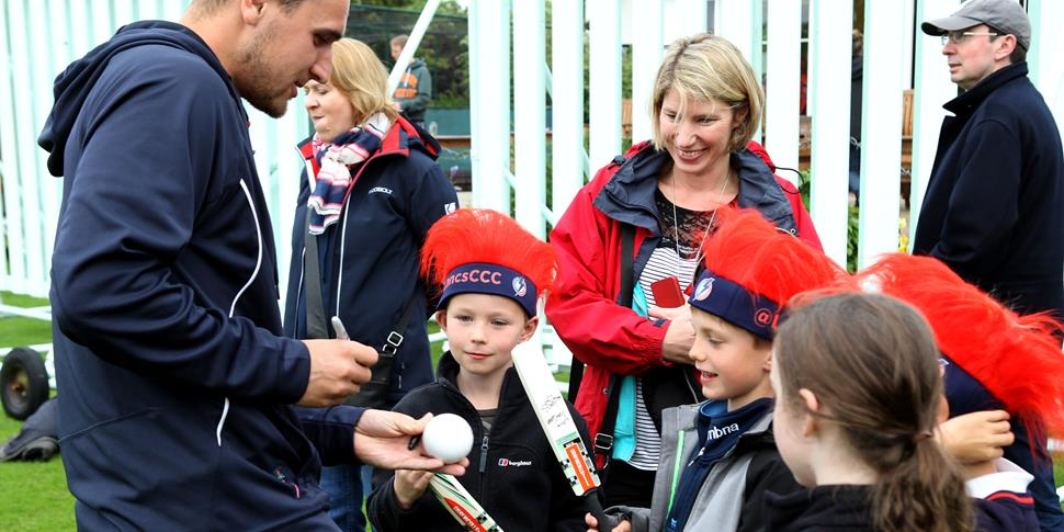 Lancashire Cricket Club Player Livingstone signs autographs.JPG