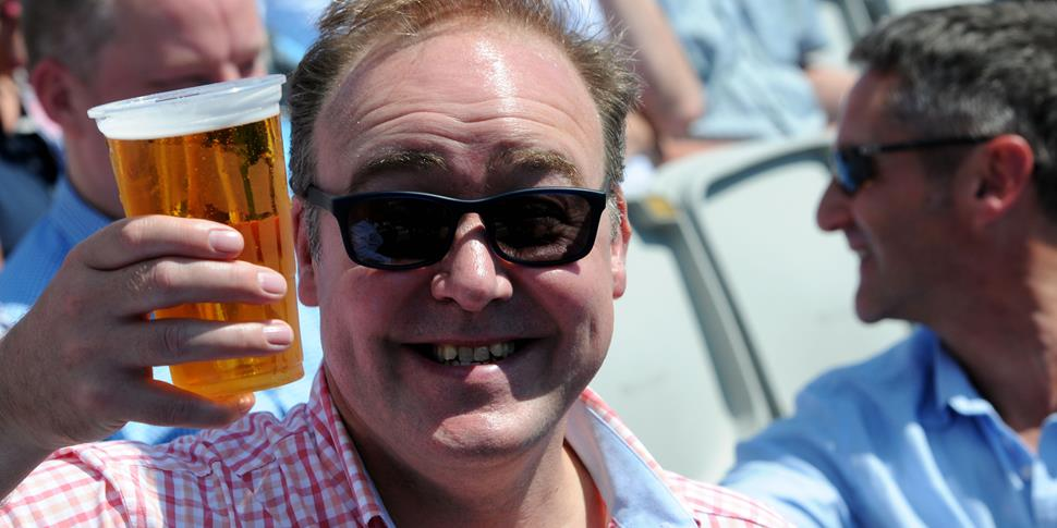 A fan enjoys a beer at EMirates Old Trafford.jpg