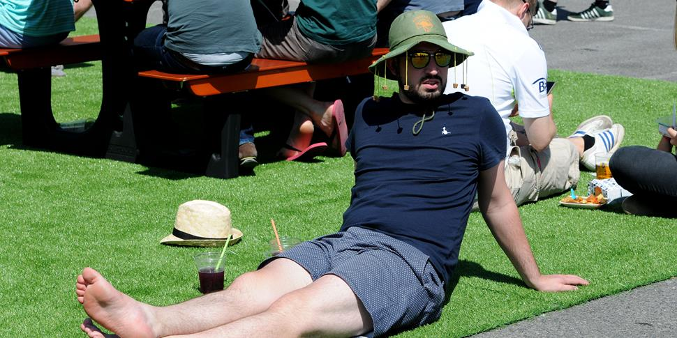 A man relaxes in the sun at Emirates Old Trafford.jpg