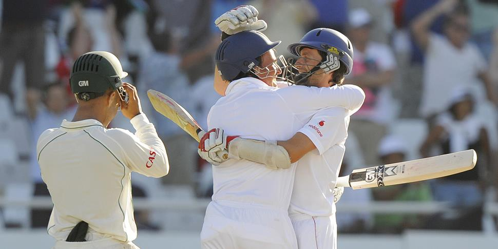 England bastmen Graham Onions and Greame Swann embrace during the third test against South Africa on Day 5.jpg