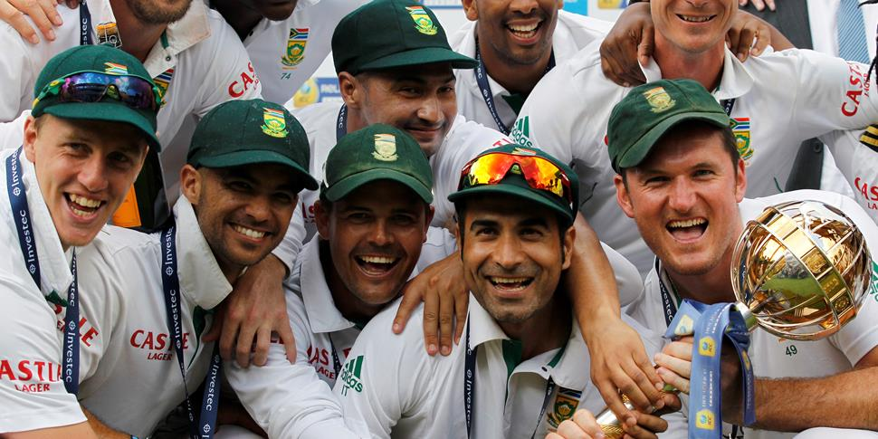 South Africa captain Graeme Smith celebrates with his team including Imran Tahir after beating England in the ICC World Test Match competition at Lord's  in 2012.jpg