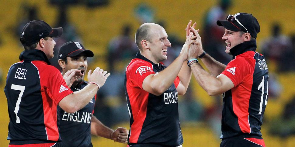 James Tredwell of England celebrates with Andrew Strauss after taking the wicket of Darren Bravo in a one-Day game against west indies.jpg