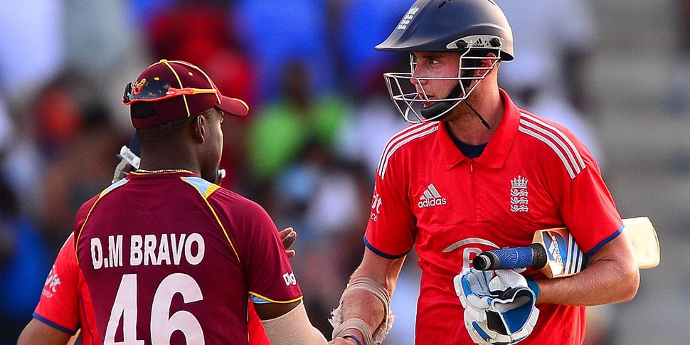 Stuart Borad shakes hands with Dwayne Bravo of the West Indies.jpg