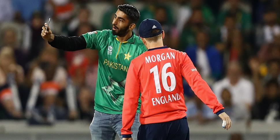 Eoin Morgan with a pitch invader at EMirates Old Trafford.jpg