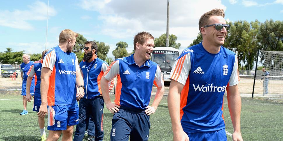 Jos Buttler laughin with the England squad.jpg