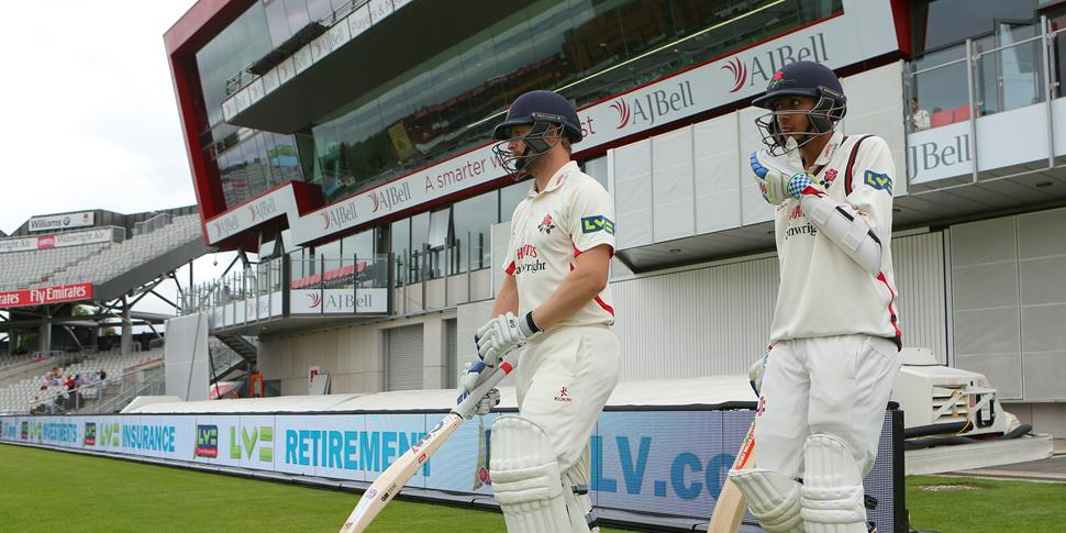 Haseeb and Karl Brown enter the pitch for Lancashire County Cricket Club at Emirates Old Trafford in the Specsavers County Championship.jpg