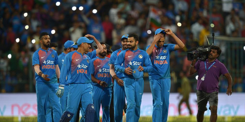 Indian team celebrates their victory against England during the third T20 cricket match between India and England at the Chinnaswamy Cricket Stadium in Bangalore.jpg