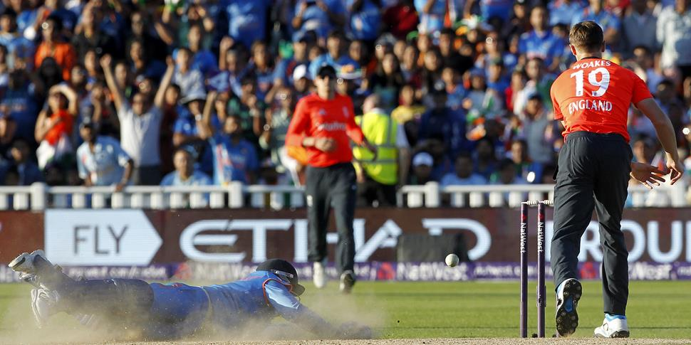 India's Ambati Rayudu (L) dives to avoid being run out England's Chris Woakes (R) during the International T20 match between England and India.jpg