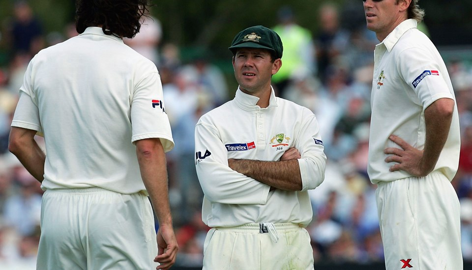 Jason Gillespie, Ricky Ponting and Glenn McGrath talk tactic during the Ashes Test at Emirates Old Trafford.jpg